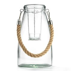"""Illuminating ideas! Light up a porch with striking rope-and-glass laterns.FEATURES•Decorative vase with twine• Can be used as a planter or a holder for a LED candle• Clear glass with lid• Metal wire to hold tealight candle midway• Twin rope for hanging• Tealights and marbles pictured are not included•10 1/4"""" x 6""""MATERIALS•Glass• Twine• MetalCARE•Wipe clean with a damp clothFor decorative purposes onlyThis is..."""