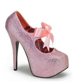 """Baby pink rhinestone Mary Jane pump has a pink ribbon strap. There is a 5 3/4"""" heel with a 1 3/4"""" concealed platform. This new line of Bordello shoes offers a large selection of sleek to shiny patents"""