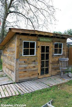 Pallet Shed Using Pallets, Old Windows & Tin Cans :: Hometalk This would make a great play house!