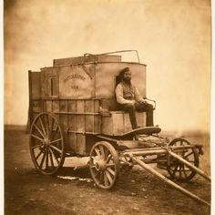 Roger Fenton was a British photographer, and one of the first war photographers. He produced hundreds of images during the Crimean War, including this one of his assistant, Marcus Sparling, pictured in Crimea in 1855 with their photographic van. War Photography, History Of Photography, Photographs Of People, Vintage Photographs, American Civil War, American History, Portraits Victoriens, Old Wagons, Crimean War