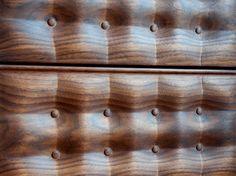 tufted wood grain headboard.