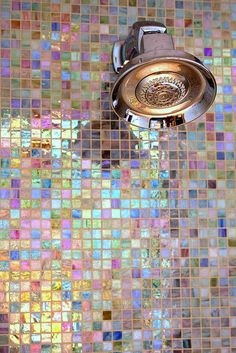 colorful tiles + bronze shower head