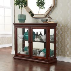 @Overstock.com - Pederson Mahogany Double Door Curio - Traditional styling and a rich mahogany finish make this curio cabinet perfect for any room in your home. Matching shoe and crown molding enclose the cabinet while glass paned doors and side panels draw your eyes to all of your wonderful collectables.   http://www.overstock.com/Home-Garden/Pederson-Mahogany-Double-Door-Curio/8285761/product.html?CID=214117 $271.99