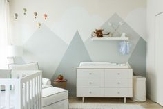 Modern baby nursery featuring a grayish-blue mountain mural - Nursery Ideas & Decor
