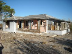 """Abandoned """"Ranch Style"""" home, near Barstow, California."""