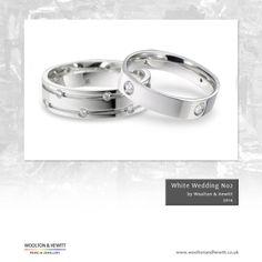 A beautiful couple! White gold, palladium or platinum wedding rings set with diamonds.