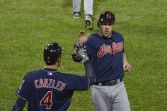 Russ Canzler #4 of the Cleveland Indians (L) high-fives Jason Kipnis #22 after he scored on and RBI double hit by Ezequiel Carrera #12 during the third inning against the Chicago White Sox at U.S. Cellular Field on September 24, 2012 in Chicago, Illinois.  (September 23, 2012 - Source: Brian Kersey/Getty Images North America)