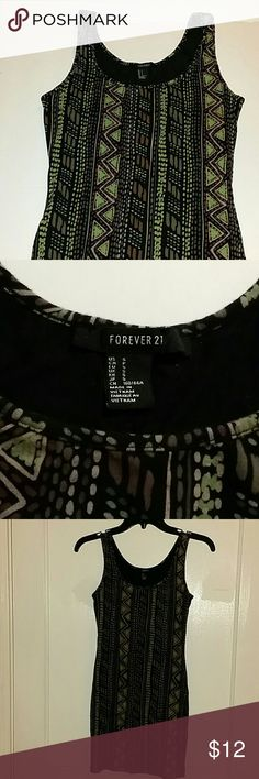 "Cute Green and Black Dress from Forever 21 Cute Green and Black Geometric shapes. 95% Cotton, 5% Spandex Bust Width is 24"" diameter Length is 30"" Forever 21 Dresses Mini"