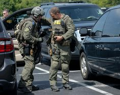 FBI HRT agents suit up before a call out.