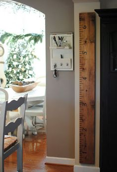 wish I had used something like this instead of the stud that is now covered with sheet rock....  still may create a hinged facia board to reveal it...  Oversized ruler growth chart, love this idea