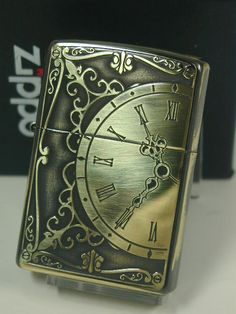 Zippo Shop DARUMAYA: Zippo writer: Zippo classical clock clock // antique // brass / brass etching sculpture << both sides processing >> ♪ fashion out of print! Cool Lighters, Cigar Lighters, Gadget, Pipes And Cigars, Smoking Accessories, Light My Fire, Zippo Lighter, Steampunk, Fire Starters