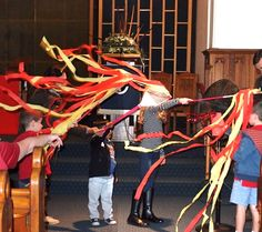 In the Messy Church Celebration time we turned on a large fan and the children held their red and yellow streamers in front of it.  They kept doing this while we sang a Pentecost song. Great event!