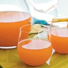 Rum Punch (1/2 cup sugar 1/2 cup water 4 cups mango juice 3 cups pineapple juice 1 1/2 cups dark rum  1/3 cup fresh lime juice 1/4 cup grenadine 3 cups club soda)