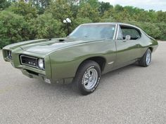 68 Pontiac GTO. LOVE the car, definitely needs a different paint job.