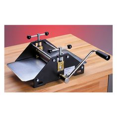 School Etching Press. Create manual chalcographic prints with the School Etching Press. This press features height adjustable solid steel rollers and round plastic covered pressure spindle and hand wheel for a more comfortable grip.