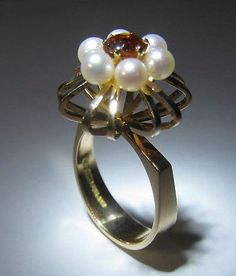 Elis Kauppi for Kupittaan Kulta (FI), vintage 14k yellow gold ring with a ruby stone and six cultivated pearls, 1970. #Finland  | finlandjewelry.com