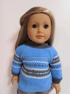 Perfect outfit for your favourite American Girl  What you get...  Pants ... soft grey corduroy jeans with front pockets and elastic waist.  Sweater ... bright blue faire isle sweater that slides easily over her head    This listing is for the sweater and jeans only Doll and shoes not included