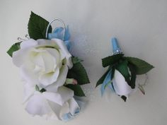 2 Piece wrist corsage and boutonniere. Could change ribbon to dark blue
