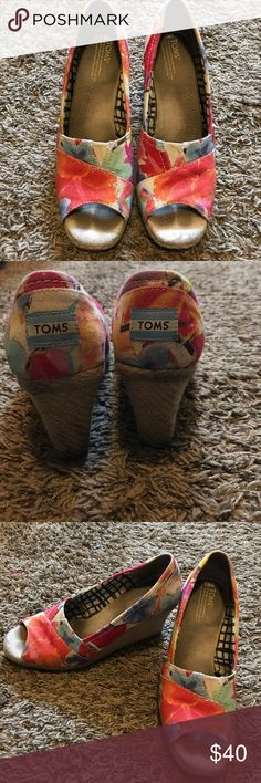 Toms colorful wedges Toms flowered wedges.  They have mild wear on them but in great shape! Toms Shoes Wedges