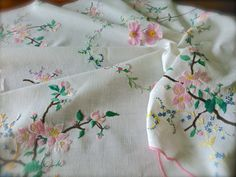 Check out this item in my Etsy shop https://www.etsy.com/uk/listing/468240144/hand-embroidered-vintage-blossom-linen