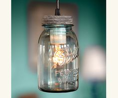 """Antique Mason Jar Lights -- Antique mason jars, some date to the turn of last century, and feature the authentic Ball logo, zinc lids, and gorgeous bubble blue glass. (40 W bulbs included; 41"""" cords with ceiling canopies for hardwire mounting; UL-approved components. Shade and patina will vary. No two exactly alike. Handmade in the USA. Jars, 3"""" diameter, 7"""" high)"""