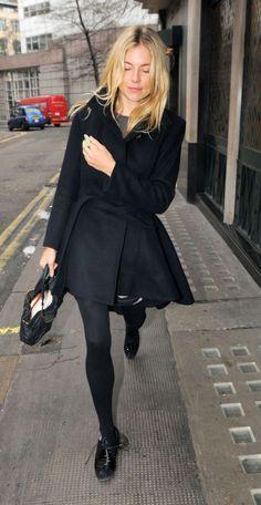 {Sienna Miller always looks stylish} ---- black flats, black tights, black wrap fitted coat