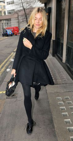 {Sienna Miller always looks stylish} ---- black flats, black tights, black wrap fitted coat