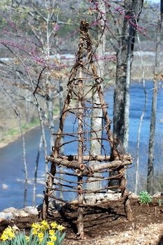 make your own trellis out of branches and grapevines or willow