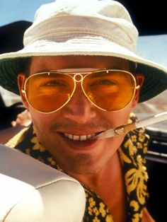 Fear and Loathing in Las Vegas  Before there was The Hangover, there was Fear and Loathing in Las Vegas. Sporting giant yellow aviators and a dazed expression, Depp plays a drug-addicted journalist tripping his way through Sin City in this 1998 cult classic.