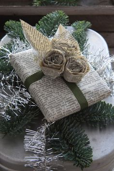 Using newspaper as gift wrap- the ultimate in upcycling