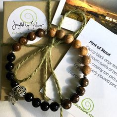 Pint of Stout bracelet - Just like a properly poured pint of Guinness!   Handmade - onyx, bronzite, & picture jasper gemstones, silver-plated pewter Celtic knot accent & optional shamrock charm.   Unisex sex, comfort-stretch design  Gift-ready packaging