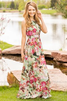 """Feel radiant in this floral maxi dress! The ruched design of the bodice, with banded waistline and high neck detail makes this dress effortless for any woman. Pair with your favorite wedges or heels and you are ready for a fabulous day. Bust in Small 28"""" Medium 30"""" Large 32"""" Xlarge 34""""Waist in Small 36"""" Medium 38"""" Large 40"""" Xlarge 42""""Length in Small 59"""" Medium 59.5"""" Large 60"""" Xlarge 60.5100% PolyesterHand Wash ColdLine DryModel is 5'7"""" and size 2 in a SmallSmall 2/4, Medium 6/8, Large 10/12…"""