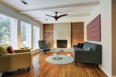 Modern fireplace. Paneled wood. Metal trim. MOD. Modern fan.