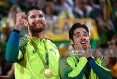 Brazil's Alison Cerutti (L) and Bruno Schmidt react after winning their men's…