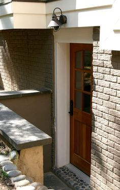 basement apartment entrance. Paint the blue brick  wtf a nice creamy khaki color Basement entry Exterior basement entrance ideas Pinteres
