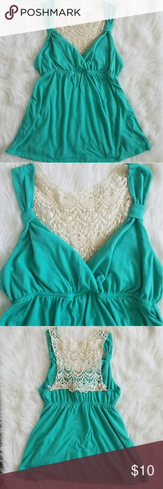 Teal and lace tank size xl No Boundries teal tank with lace on the back. Tops Tank Tops