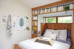 """Don't Let Any Space Go To Waste""""In our house, the most unique storage solutions are the built-ins beneath the bed and couch. The entire bed has storage underneath it via four separate doors, which is great. It's the most ingenious use of space here."""" #refinery29 http://www.refinery29.com/whitney-leigh-morris-venice-beach-house-home-tour#slide-12"""