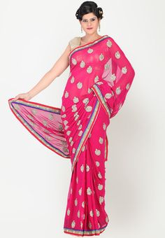 Fuschia coloured saree for women from Chhabra 555. Made from georgette, it measures 5.5 metres and comes with a 0.75 metres blouse piece. Embellished with exquisite kundan work, this fuschia coloured saree from Chhabra 555 is perfect for the most special of occasions. The use of georgette base creates a fine balance with heavy embroidery.