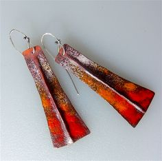 Fold form torch fired enamel earrings in red and orange on fold formed copper   $55