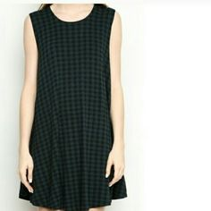 Brandy Melville Green Plaid Alena Dress 10/10 condition Never worn by me  On the longer side. If you're shorter than 5'3, you may have to get this hemmed.  I also accept P a y P a l and Venmo at a discounted price. NO TRADES/SWAPS.  Please see my instagram for more items or inquiries ----> @rmbbtq Brandy Melville Dresses Mini