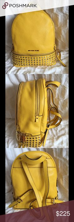 MICHAEL KORS This is the Michael Kors Rhea medium gold studded backpack in a bright sun yellow.  It is brand new with tags.  This is a great bag for school, work or anytime hands free carrying are essential!! Michael Kors Bags Backpacks