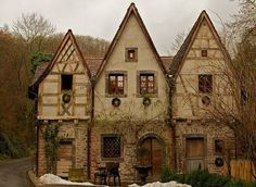 The English Country Cottage.  Timber Frames hold the structure of the building and the space between the timbers can be filled with straw bales & plastered.