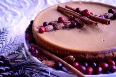 Gingerbread cheesecake with pecans, cranberries, and cinnamon sticks. By Rachel Maria Cakes.