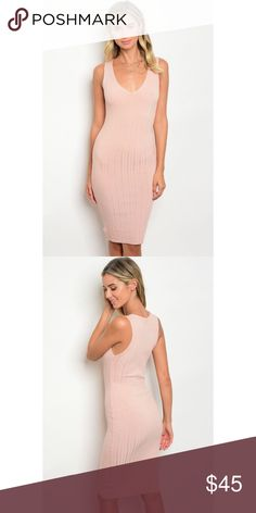 """New peachy pink ribbed bodycon midi dress . Brand new from my boutique  . Model is wearing the exact product  . Fabric Content: 95% POLYESTER 5% SPANDEX . Made in the USA                Any questions? Don't hesitate to ask  ✨ Use the """"buy now"""" or """"add to bundle"""" feature to purchase ✨ Dresses Midi"""