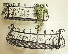 Explore the French country with the use of our wrought iron wall planters highlighting scroll designs.