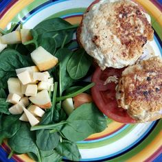 Home made chicken burgers on french bread with tomato and purple onion with a spinach apple and gouda salad #cleaneating #healthy #summer #cooking #foodporn #salad