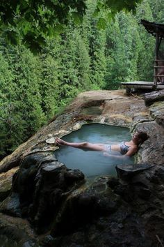 "The Umpqua Hot Springs Trail is a short 0.3 mile hike to the springs. A ""tub"" is hewn out of the travertine deposits surrounding the springs. The springs, at a temperature of 108 degrees, is located on a bare rock face 150 feet above the North Umpqua River. From the tub, there is a view of Surprise Falls across the river."
