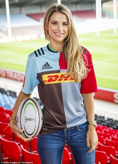 DJ Vogue Williams models the new Harlequins jersey in the stand at Twickenham Stoop holding a club ball