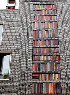 A Dutch building. A 10 meter high wall in amsterdam west, designed with ceramic books