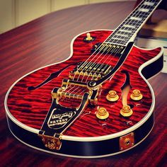 The Led Paul Florentine quilt in Fire Tiger w/ Bigsby. Les Paul Florentine Quilt in Fire Tiger with Bigsby.